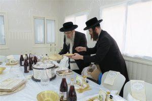 Rabbi Rosenfeld director of the org. is preparing the seder table