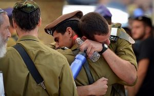 Friends and family attend the funeral of IDF Sgt Aviv Levi of the Givati Brigade in Petach Tikva on July 22, 2018.